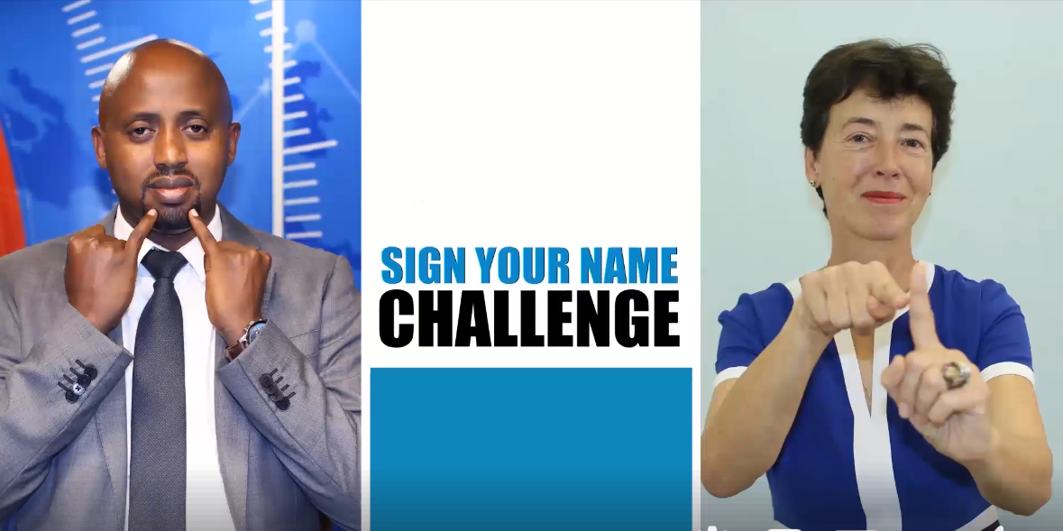 "At the left side, a man looks at the camera while signing ""information"". At the right side, a woman facing the camera is also signing. In the middle, the text says ""Sign Your Name Challenge""."