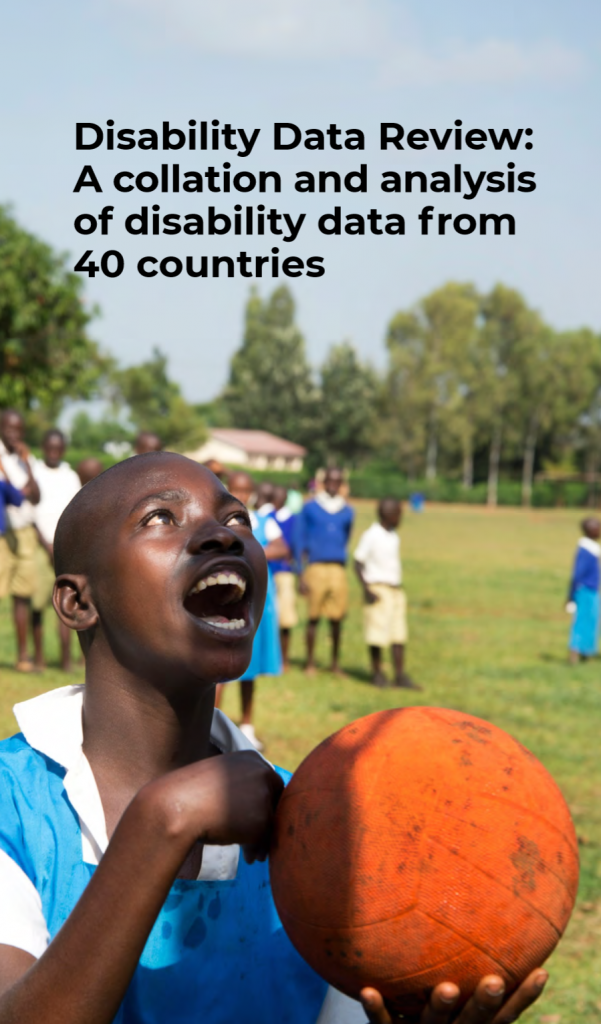"Cover of a report entitled ""Disability Data Review: A collation and analysis of disability data from 40 countries"". The color image on the cover shows an adolescent boy looking toward the sky while holding a large orange ball in his hands. More children are playing behind him in an open green field. Trees are visible further in the background."