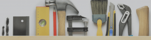 Photograph shows working tools used for producing things, such as hammer, paint brushes, wrench, ruler, pencil, saw, etc.