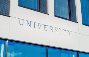 """Lettering on the side of a building says """"University""""."""