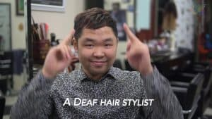 Screenshot from video in which Thành Nguyễn explains the start of his Vietnam Deaf Hairstyling Business