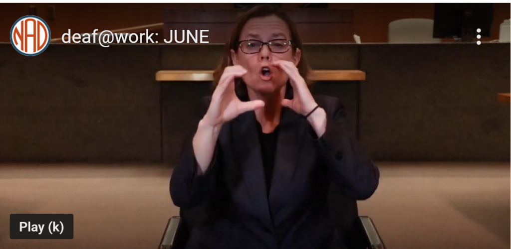 Screenshot of a video that shows a certified deaf interpreter story by June, who is facing the camera. The logo for the National Association of the Deaf (NAD) in the U.S. is in the upper left corner.