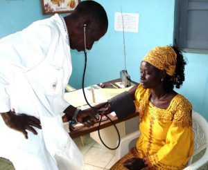Photo shows a doctor taking a patient's blood pressure at the hospital.
