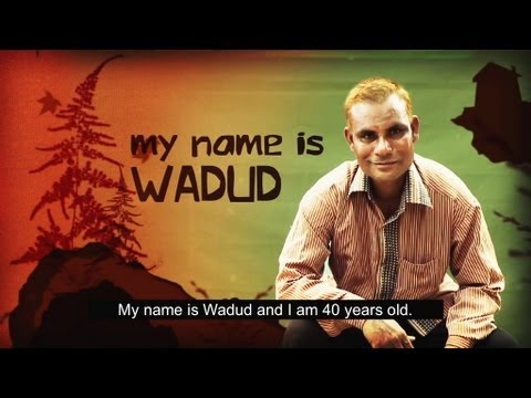Screen shot of video featuring Wadud, a Deaf Bangladesh leader. We see Wadud seated, facing the camera.