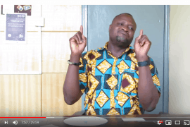 Screen shot taken from a video that shows Robert Sampana, GNAD Project Advocacy Officer, signing to the camera.