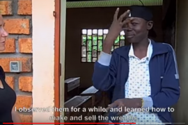 Screenshot shows a video with a young deaf man signing to the camera. English captions are at the bottom of the screen.
