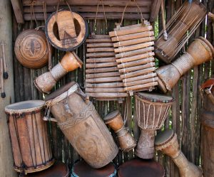 Photo shows an assortment of brown wooden percussion instruments.