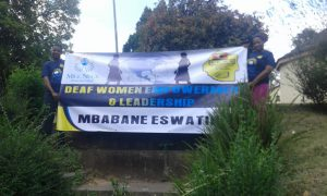 "A banner with words ""Deaf Women Empowerment and Leadership"""